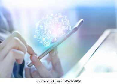 businessman hand holding smart phone connecting to internet and social media icons, people with technology concept background