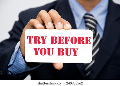 Businessman hand holding TRY BEFORE YOU BUY concept