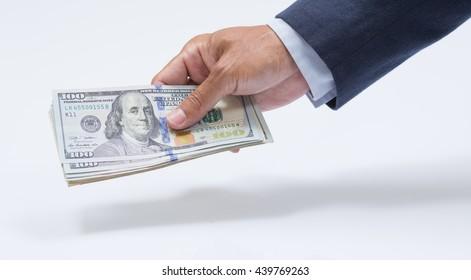 Businessman hand holding US dollar, USD. bills