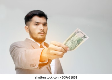Businessman hand holding US dollar, USD. bills, offers dollar bank note money isolate background