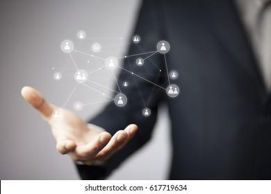 Businessman hand holding virtual social media buttons