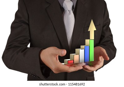 businessman hand holds graph bar growth