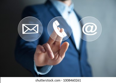 Businessman hand icons for phone, mail and e-mail contact information