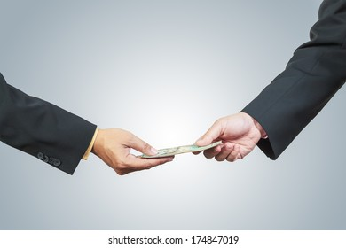 businessman hand and money to other for corruption concept