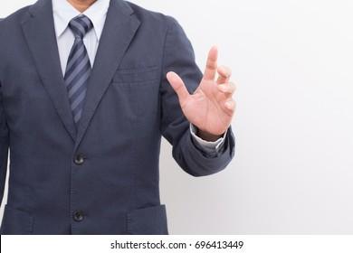 Businessman hand on white background. blue suit and blue necktie
