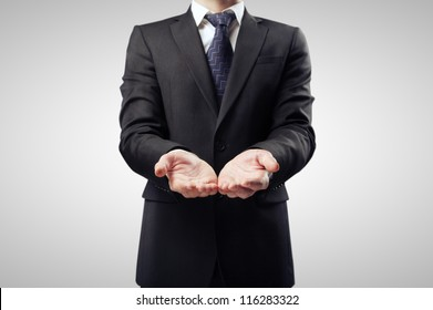 businessman with hand outstretched forward