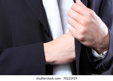 businessman hand in  pocket of a jacket