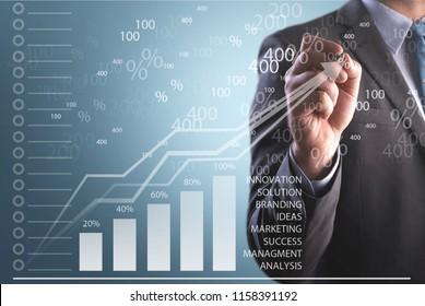 Businessman hand point graph growth