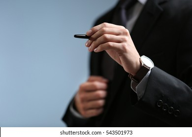 Businessman hand pointing, color background