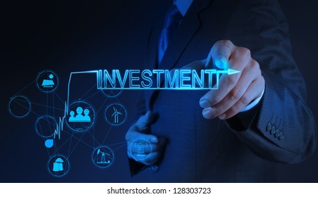 businessman hand pointing to investment as concept