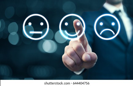 Businessman hand pointing the smiley face icon from screen as positive feedback concept