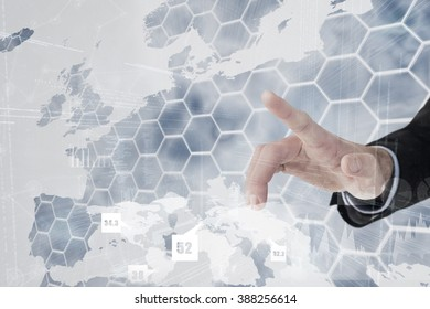 Businessman hand pointing something against background with europa map