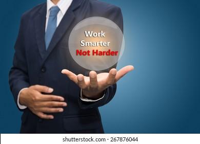 Businessman hand pointing Work Smarter Not Harder