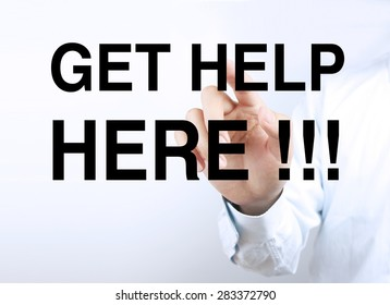 Businessman hand is pressing the concept text of Get help here.