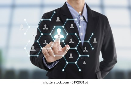 Businessman hand pressing icon on networking system concept employment,recruitment, hiring people social network communication.