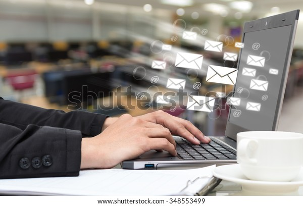 Businessman hand pressing the keyboard for sending the e-mail from labtop computer, business technology concept