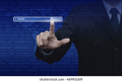 Businessman hand pressing search www button over digital world map with binary code blue background, Searching system and internet concept, Elements of this image furnished by NASA