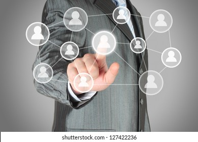 Businessman with hand pressing virtual social media button