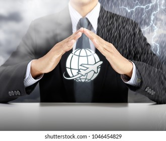 businessman hand protect plan with storm background, safety and insurance