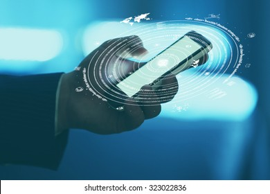 Businessman hand pushing business graph on smartphone.  Futuristic button