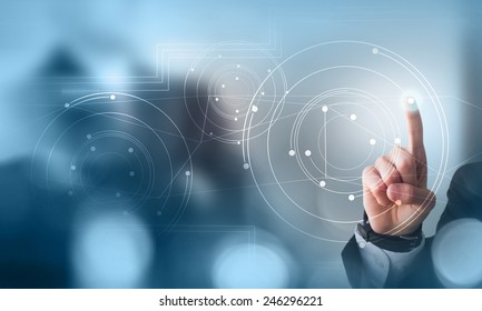 Businessman hand pushing button on touch screen interface