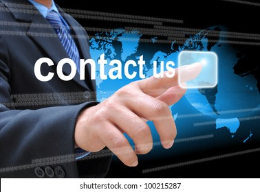 businessman hand pushing contact us button on a touch screen interface