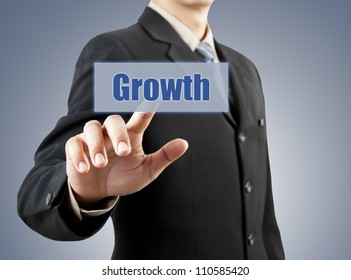 businessman hand pushing growth button