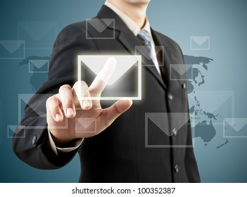 businessman hand pushing mail sign