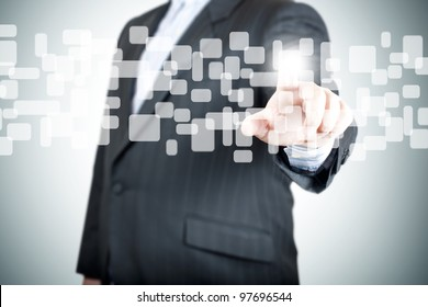 Businessman hand pushing on a touch screen interface