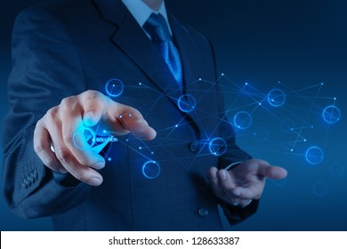 businessman hand pushing solution diagram on a touch screen interface