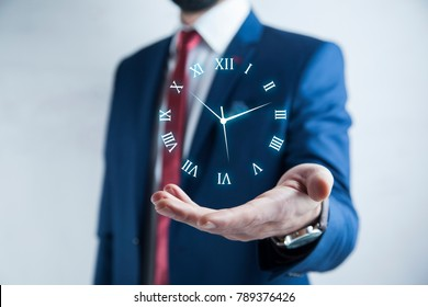 Businessman hand pushing time icon on virtual screen