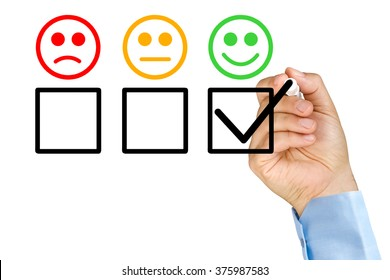 Businessman hand putting check mark with marker on customer service evaluation form on clear glass whiteboard isolated