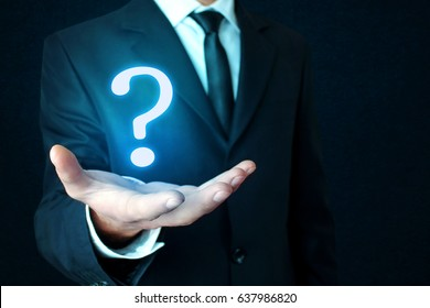 Businessman hand with question mark