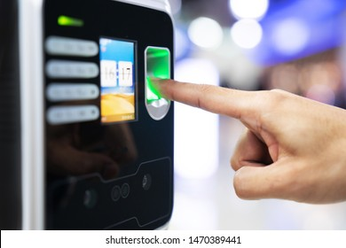 Businessman hand scanning finger on machine,Technology concept, Business concept,