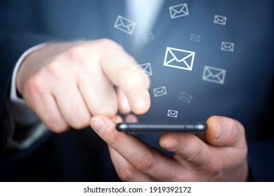 Businessman hand sending e-mails. Business economic technology working connect concept.