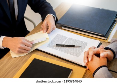 businessman hand sending a resignation letter to executive boss dismissed worker quit out from company, Change job, unemployment, resign concept.