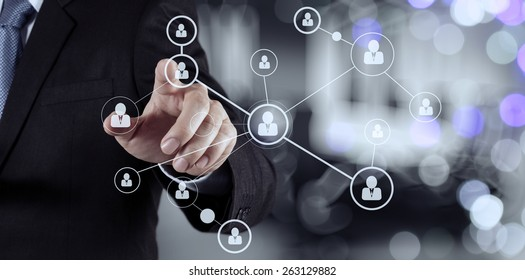 businessman hand showing human icon flow chart on new modern computer as concept with bokeh exposure