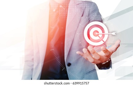 Businessman hand showing on target business concept with blank copyspace area for text or slogan, against grey background - Shutterstock ID 639915757
