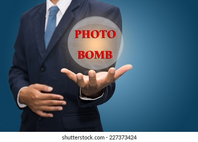 Businessman Hand Showing PHOTO BOMB