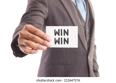 """Businessman hand showing someone his business card with""""WIN WIN"""" message"""
