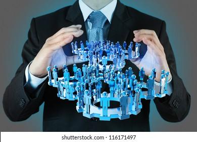 businessman hand shows blue gear to success as concept