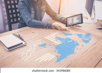 businessman hand shows logistics diagram as concept. world wide business concept on wood table.