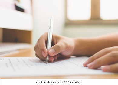 Businessman hand signing the document business contract agreement