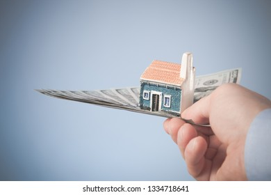 Businessman hand suggesting you money for house purchase