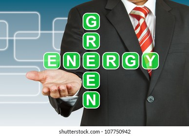 Businessman hand with text Green Energy