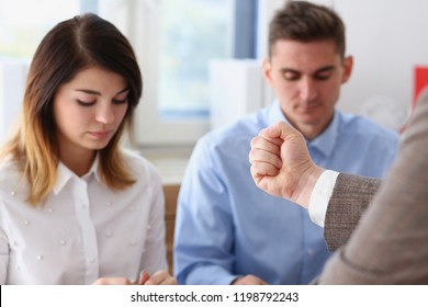 Businessman hand threatens his hired employees threatens staff with dismissal looking for guilty accuses of no fulfillment of tasks and delay in action plan at the enterprise participants fists finger