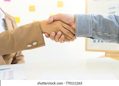 Businessman hand together Handshake for business project teamwork , business people deal success