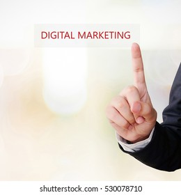 Businessman hand touch digital marketing word over blur background, digital marketing concept, businees and technology
