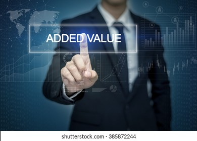Businessman hand touching ADDED VALUE  button on virtual screen