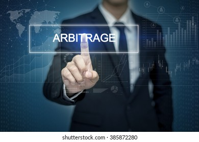 Businessman hand touching ARBITRAGE   button on virtual screen